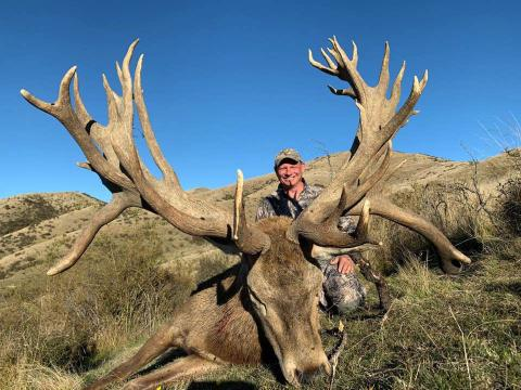 Hunter with red stag
