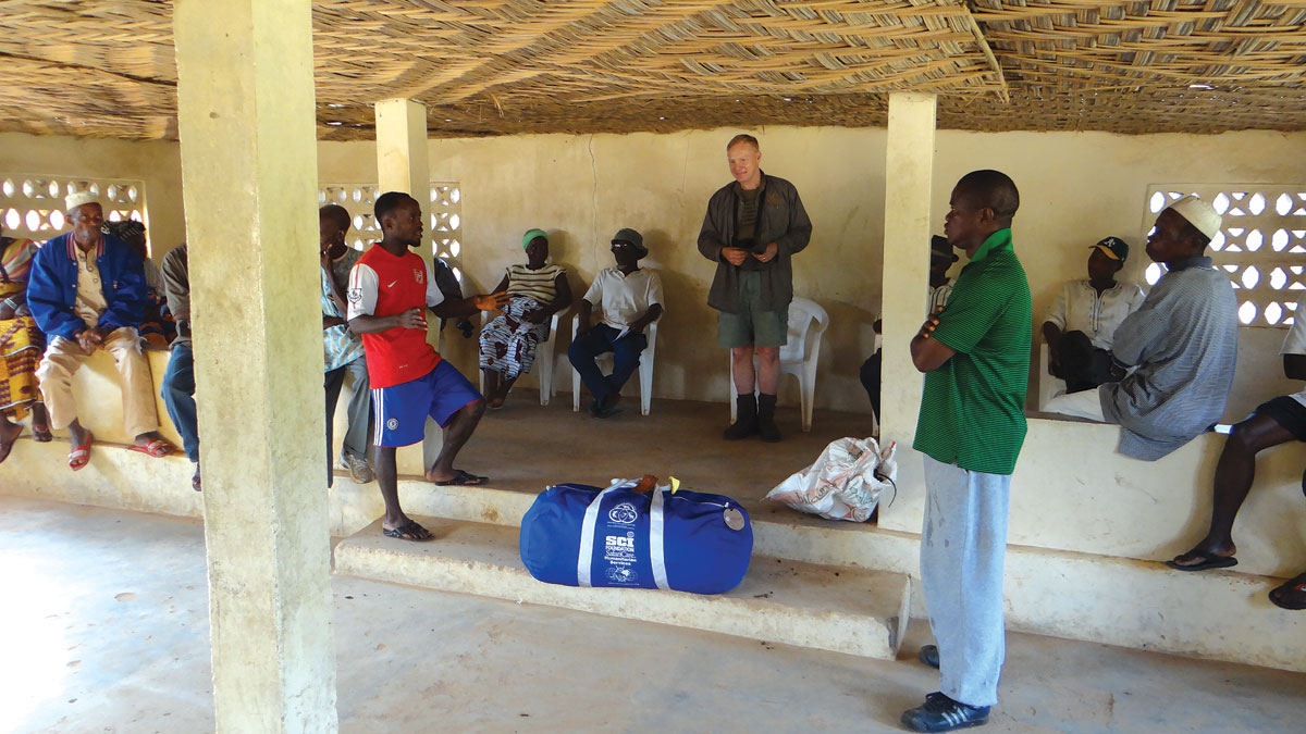 The Blue Bag, a gift from Tennessee Valley Chapter, was first presented to the village elders in Zuie, northwestern Liberia, and then taken to the school for distribution.
